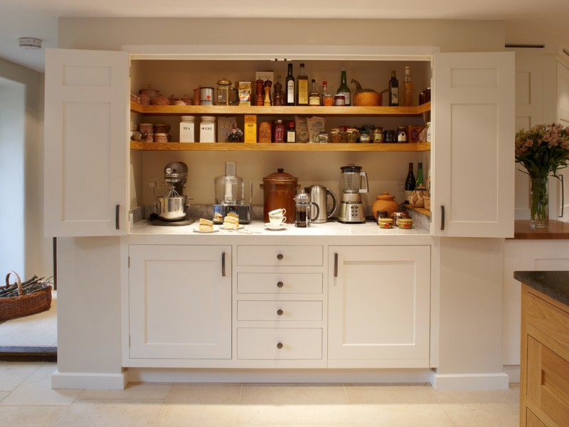 small kitchen appliance storage white wooden pantry wooden shelves mixer blender bottle white drawers spices jars white top