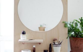 small plywood with mirror and shelves on pegboard