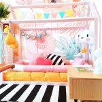 Soft Colored Big Flowers Wallpaper, Pink Wooden Bed Platform, Black White Stripe Rug, Low Wooden Bedside Table