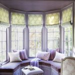 Sunroom In Round Alcove, Purple Round Bench, Purple Seat, Purple Wall, Windows With Shade, Glass Table, Ottoman