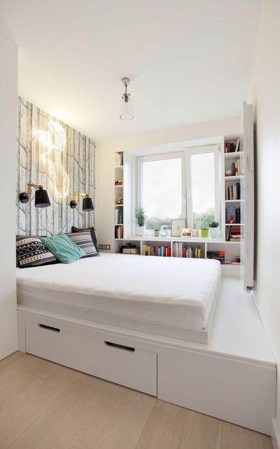 teen bedroom, white wide platform, white shelves along windows shape, wooden floor, storage under the platform