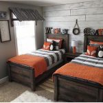 Teen Boys Room, Grey Wall, Grey Rug, Dark Bed Platform, Orange Blanket And Pillows, Window, Side Table