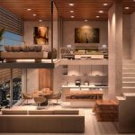 Two Levels Space, Beife Floor, Beige Sofa, Brown Dining Set, Kitchen With White Cabinet, Wooden Island, Bedroom In The Upper Level, Living Room In The Upper Level