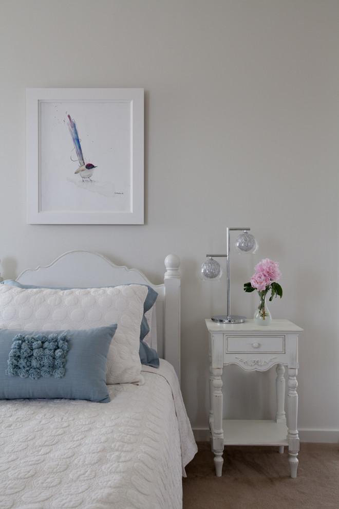 very narrow bedside table white frame white bedding blue pillows white wall drawer white headboard glass flower vase table decoration
