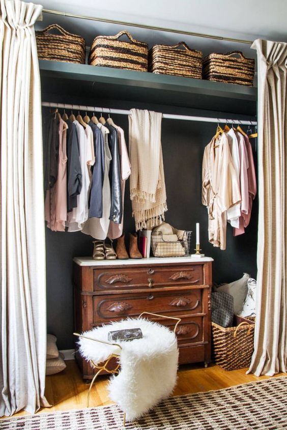 walking closet on the wall with curtain, rails, shelves above, cabinet inside