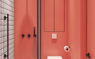 white square tiles on the floor and one side of the wall, peach painted wall and door, white floating toilet, black framed partition, black rail, black shower