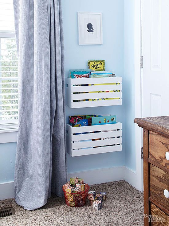 white wooden floating boxes for children's bookcase, blue wall, beige rug, wooden cabinet, blue curtain