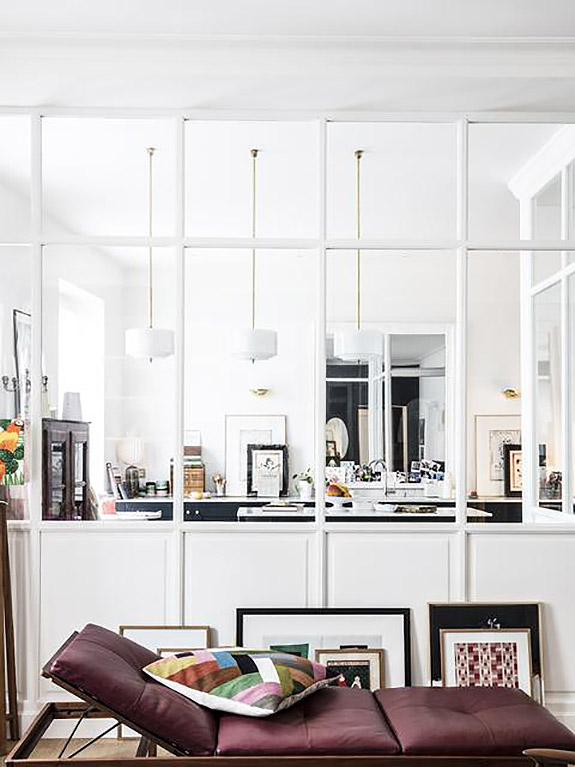white wooden framed half glass partition between kitchen and living room, white pendants, purple sateen lounge chair