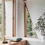 Window Seat, Brown Wooden Bench, Wooden Framed Window, White Open Brick Wall, Triangle Window In The Corner