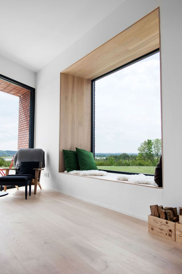 window seat, wooden layered on the seating, wall , ceiling, white wall