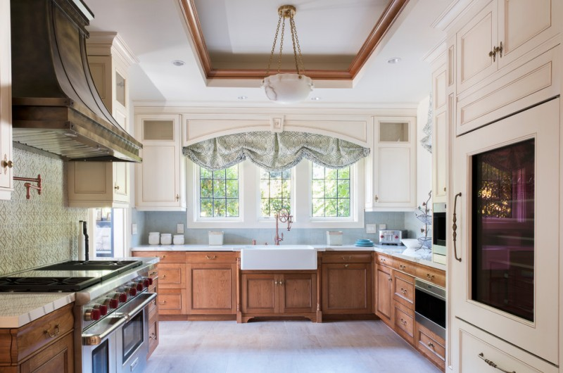 window swag valances sink pull out faucet white windows white and wooden cabinets stovetop rangehood pendant lamp tray ceiling