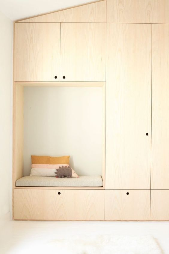 wooden built in cupboard, seating nook on the side