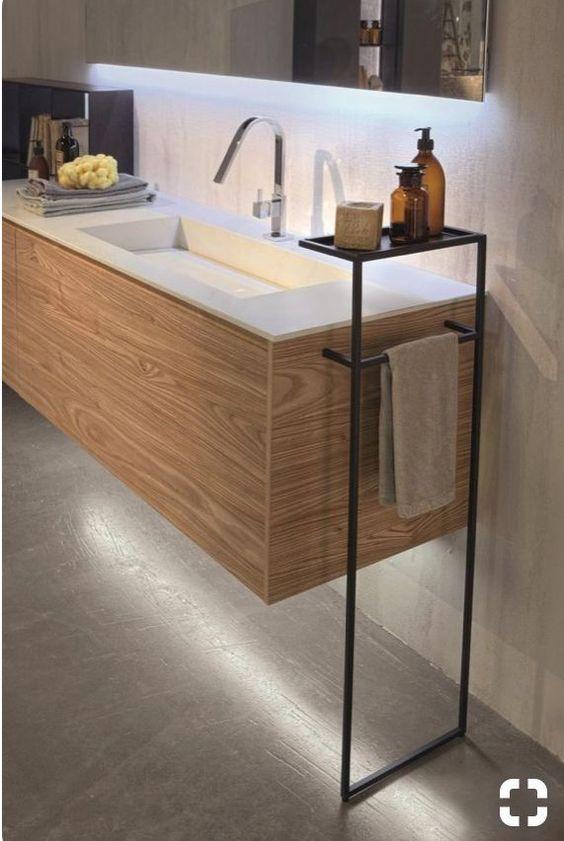 wooden floating vanity, white top, silver faucet, black metal holder
