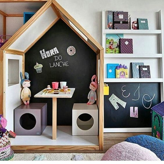wooden house box, small table and boxes for chair inside, display shelves beside