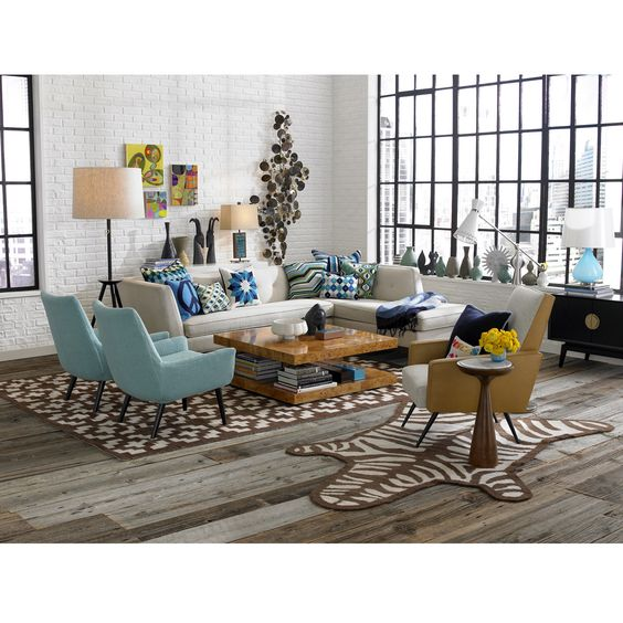 04 living room, wooden floor, brown rug, white open brick wall, white corner sofa, blue chairs, wooden coffee table, glass window, floor lamp