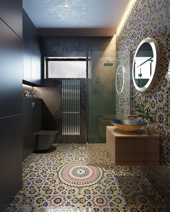 04 white orange blue patterned tiles on the floor and wall, wooden floating vanity, golden round sink, round irror, black wall, black floating toilet