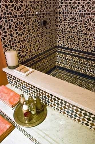 05 dark Moroccan tiles on the wall, inside the tub, and outside the tub, white top