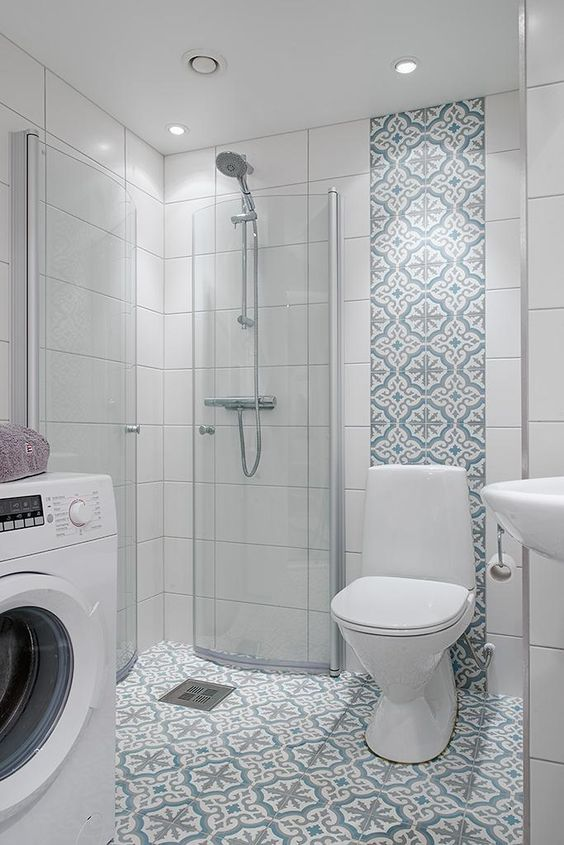 08 blue patterned tiles on the floor and wall line, whitewall tiles, white toilet, white sink, glass partition shower, white machine