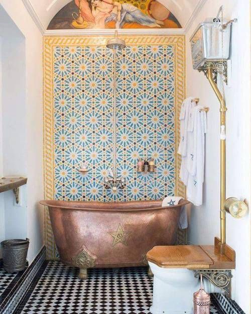 09 blue yellow patterned tiles on statement wall, white wall, copper tub, white toilet with wooden cover, black white patterned floor, golden line