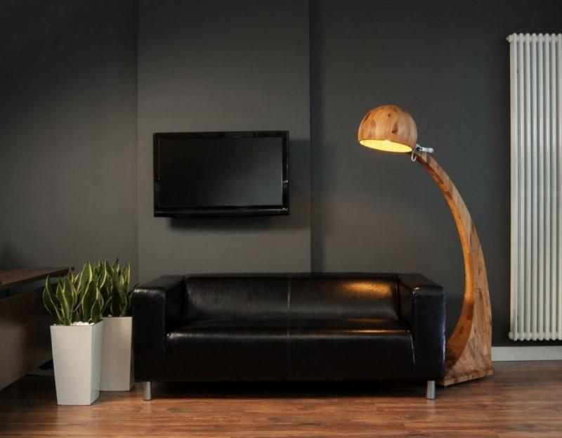 3 wooden standing lamp in contrast with dark tone of room