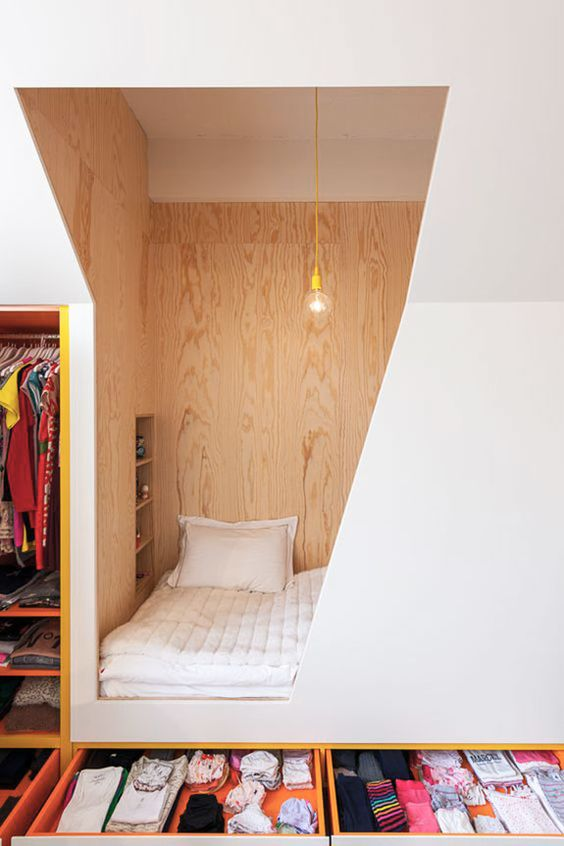 alcove, geometrical hole, bed, drawers at the bottom