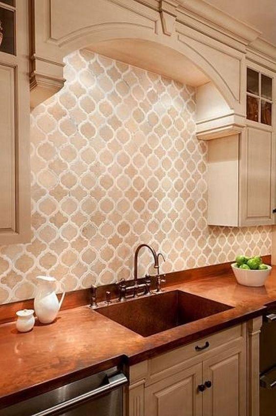 arabesque backsplash tile, arch ceiling, white upper cabnet, brown marble kitchen top, silver cabinet
