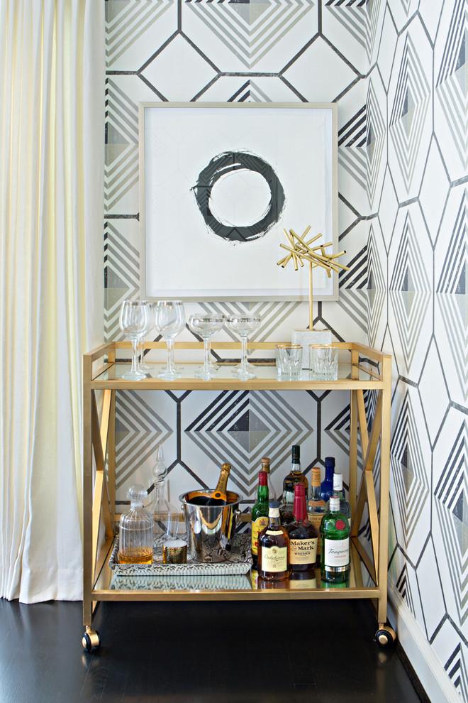 bar server furniture black and white wallpaper white curtain gold framed glass bar cart wine glass glass bottles dark flooring artwork