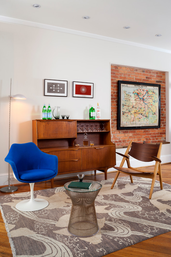 bar server furniture brick accent wall blue chair glass cocktail table patterned area rug wooden floor wooden chair wooden bar server white floor lamp