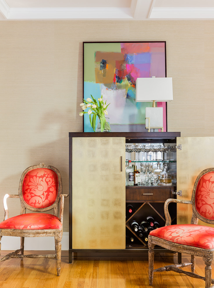 bar server furniture colorful artwork wooden floor wooden chairs red cushions white table lamps wooden bar cabinet wine storage glass shelves