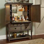 Bar Server Furniture Wooden Bar Cabinet Wooden Floor Brown Patterned Area Rug Drawers Wine Glass Teapot Wine Rack