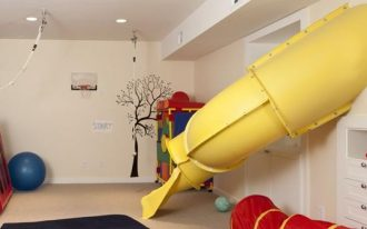 basement, beige floor, beige wall, yellow slide, toys, matrass