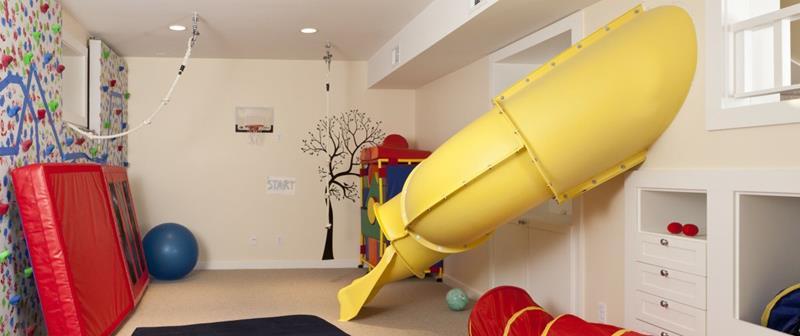 basement, beige floor, beige wall, yellow slide, toys, matrass