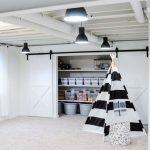 Basement, White Floor, White Wall, White Ceiling, Black Pendants, Wooden Shelves Storage, Black White Striped Tent