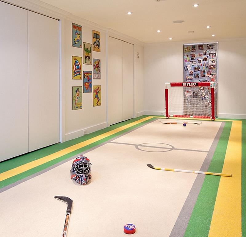 basement, white wall, hockey field with goal post