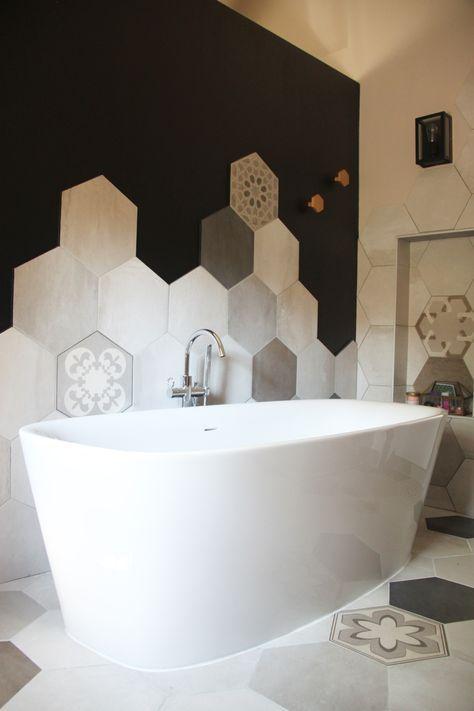 bathroom, black wall, white wall, white marble hexagonal tiles, white tub