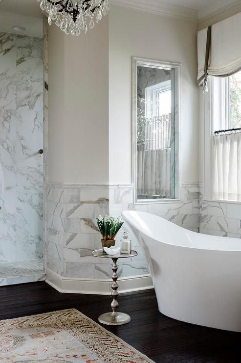 bathroom, dark wooden floor, white marble wall, white wall, crystal chandelier, white tub, white shade