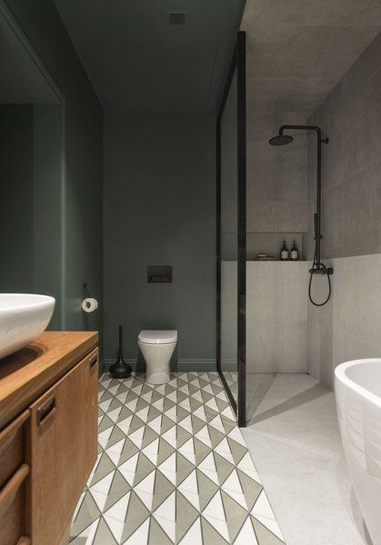 bathroom, green painted wall and ceiling, floor tiles, wooden cabinet, white sink, white marble floor & marble wall, white tub, white toilet