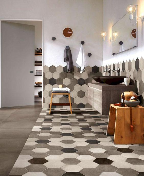 bathroom, grey floor tiles, hexagonal floor and walltiles, wooden floating vanity, stone sink, wooden stool, mirror