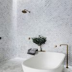 Bathroom, Grey Floor, White Grey Tiny Fish Scale Tiles On The Floor And Wall, White Tub, Golden Faucet