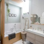 Bathroom, Grey Floor, White Hexagonal Tiles, White Wall, White Textured Wall, Green Wall, Round Mirror, Wooden Floating Cabinet