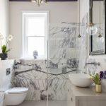Bathroom, Grey Floor, White Toilet, Grey Vanity With Marble Top, Beige Wall, Star Pendant, Clear Bulb Pendants