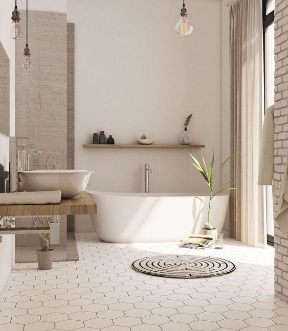 bathroom, hexagonal floor tiles, white wall, white tub, brown curtain, low wooden vanity, white sink, wooden floating shelves, clear bulbs pendant, open brick posts