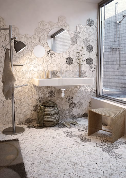 bathroom, hexagonal marble on floor and wall, white wall, tiny square tiles on shower, wooden stool, white floating sink, floor lamp, round mirror