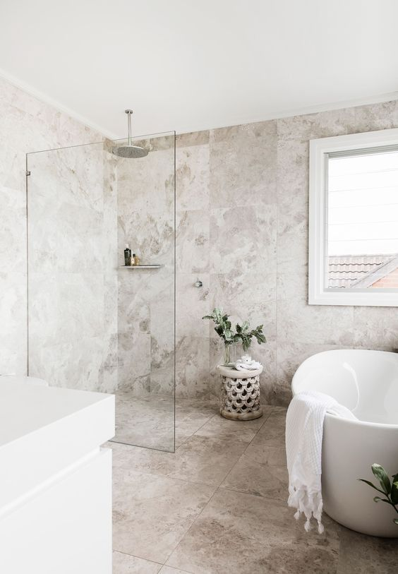 bathroom, off white marble on the wall and floor, white ceiling, white tub, window