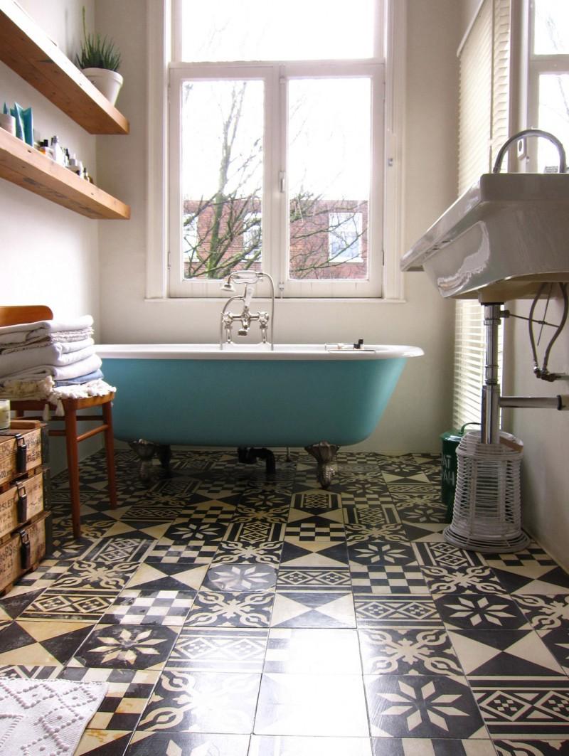 bathroom, patterned tiles, white wlal, green tub, floating sink, wooden floating shelves, glass windows