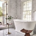 Bathroom, Tiny Patterned Tiles Floor, Grey Marble Subway Walls Tiles, White Wooden Framed Windows, White Tub, Low Round Side Table, Wooden Stool