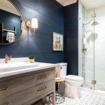 Bathroom Wall Decorating Ideas Wall Mirror Wall Sconce Wooden Vanity White Sink Gold Faucet Gold Shower Head White Tile Glass Shower Door Toilet Side Table