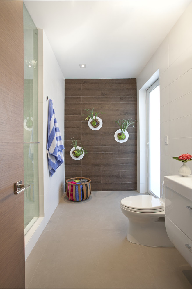 bathroom wall decorating ideas wooden accent wall planter glass shower door frosted glass windows white vanity towel holder basket