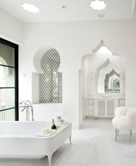 bathroom, white floor with details tiles, white wall, white ceiling with star lamp, arch to the white vanity, arch with patterned window, white tub with legs