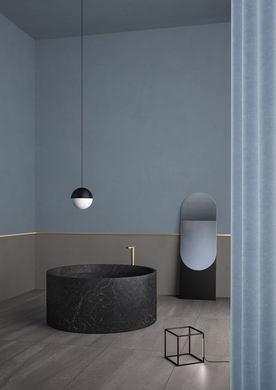 bathroom, wooden floor, beige wainscoting wall with golden lines, blue wall, mirror, black wire cube, black white pendant